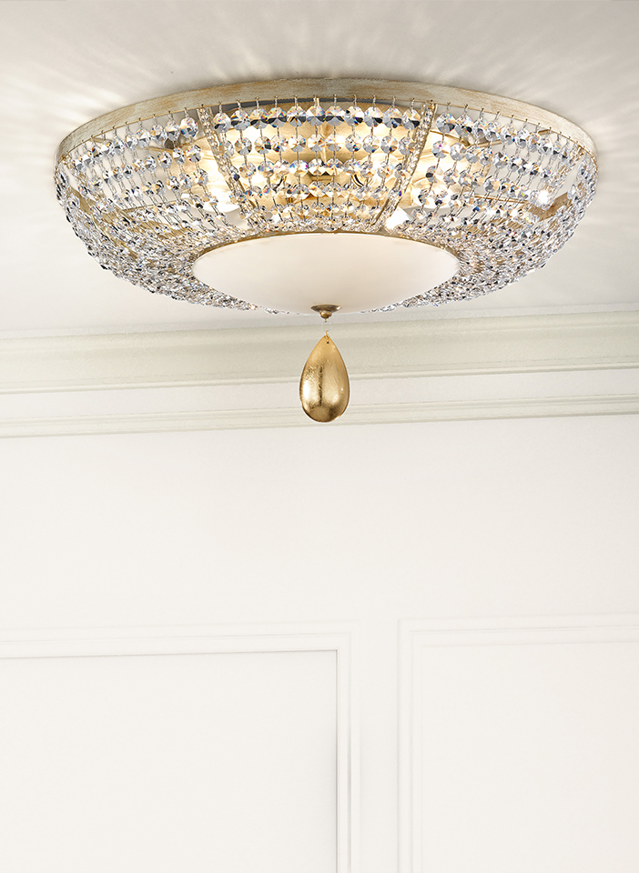Metal frame decorated with transparent glass beads. Shantung fabric lampshades. Leaf pendants.