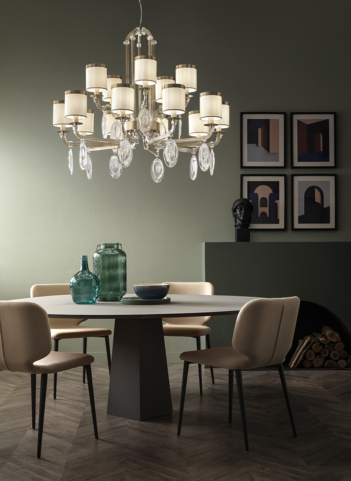 Metal frame and arms covered with glass. Crek glass pendants and satin lampshades.