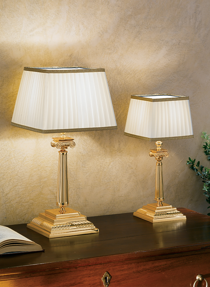 Gold plated solid brass base. Shantung lampshades
