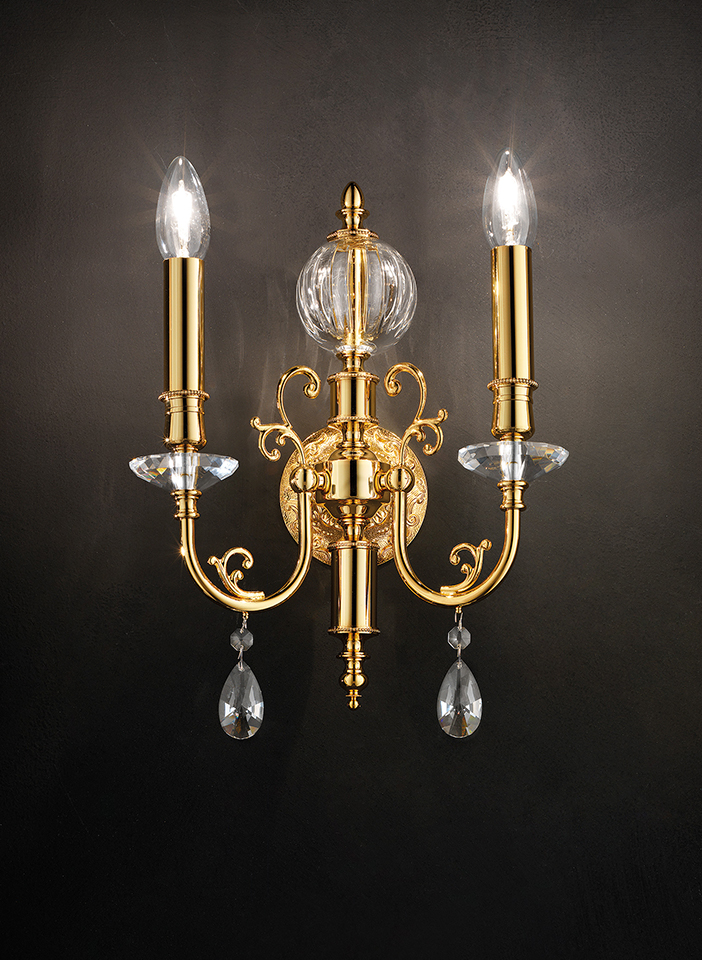 Cast brass and metal frame. Crystal pendants